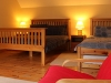 Family room 2: Large, versatile bedroom including double bed, single and sleepover bed with TV & DVD